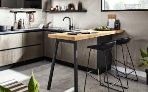 L-keuken met bar en staal fineer keukendeurtjes en lades, Häcker industriële keuken Steel GL, metallic dark brushed