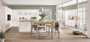 Witte modern klassieke keuken met kookeiland en bar, Nobilia